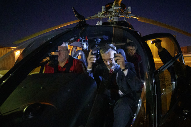 Chancellor Ronnie Green (right) boards a helicopter for a night flight over campus during the Glow Big Red event on Feb. 14.