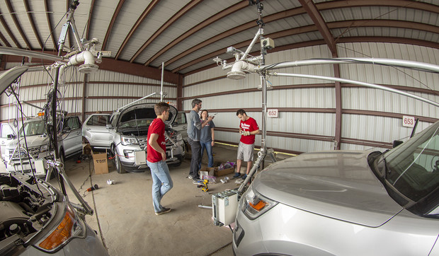 Nebraska's Adam Houston and student researchers discuss the mesonet vehicle builds and upgrades in a shed by the university motor pool. Nebraska students have customized four of the storm chase vehicles since 2015. Three will join the TORUS project this summer. The fourth was purchased for a Central Michigan University research project.