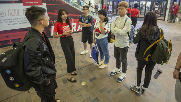 Nebraska's Bosi Fang (second from left) talks with students from China after they arrived in the Lincoln Airport on Aug. 16. Fang, a senior from Lincoln, uses her knowledge of Mandarin to talk with and answer questions from Chinese students.