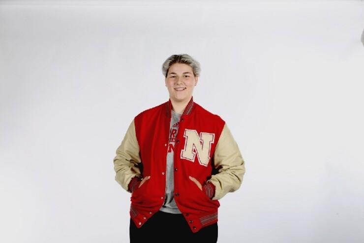 Emily Cheramie poses with her Husker letter-winner's jacket.