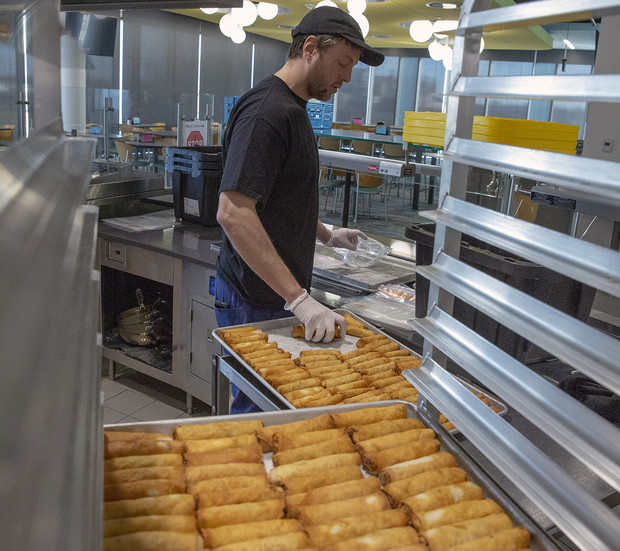 Cameron Gereau, a dining service team leader in the Cather Dining Center, packages the precooked egg rolls for freezing. The Cather team crafted some 5,500 egg rolls during the week of Jan. 6. Of that total, 5,000 will be served in the Cather Dining Center, while the other 500 were created for a retirement celebration.
