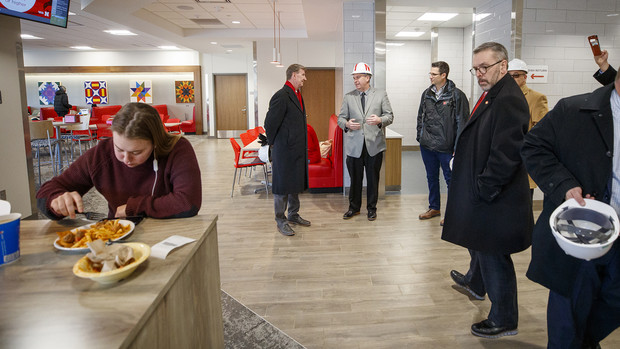 Ryan Lahne (center, in hard hat), interim director of the Nebraska East Union, discusses the new East Campus dining center during a tour on Jan. 16. The new dining facility opened in the fall semester.