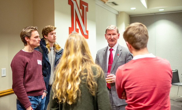 Ted Carter talks with students during a dinner on Jan. 16. The event featured leaders from recognized student organizations, including the Association of Students of the University of Nebraska.