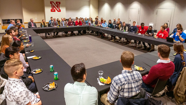 Student leaders talk with Ted Carter during the Jan. 16 pizza dinner in the Nebraska Union.