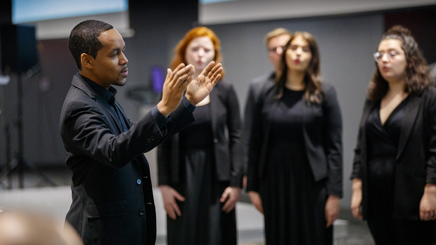 Marques Garrett, assistant professor of music, directs the UNL Chamber Singers during an MLK Week brunch performance.