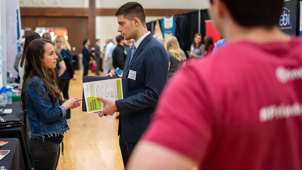 Nick Vetter, a junior management major, meets with a Nelnet recruiter during the 2020 Spring Career Fair. The fair included 160 companies from across the country looking to connect Nebraska students with both job and internship opportunities.