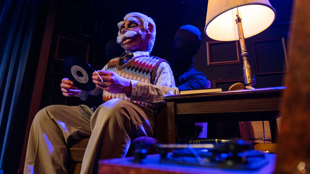"""Actor Philip Crawford (in black morph suit), a junior theatre arts major, performs as the grandfather character in the Nebraska Repertory Theatre's production of """"A Thousand Words."""""""