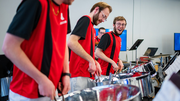 Members of Nebraska Steel, a steel drum band for students in the Glenn Korff School of Music, smile as they perform during the third annual Arts Advocacy Day on March 6. Hosted by College of Fine and Performing Arts, the event celebrates student artwork and performers, exposing the university community to statewide arts advocacy efforts.