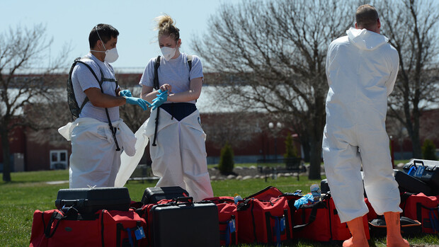 Members of the 155th Medical Group follow health safety protocols by wearing personal protective equipment while preparing to open a testing station in Grand Island on April 7.