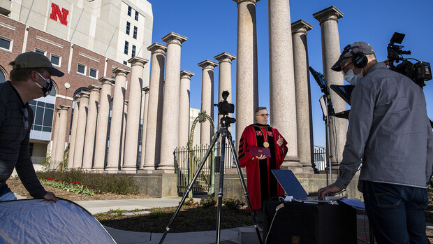 Curt Bright (from left), Chancellor Ronnie Green and David Fitzgibbon ready for a video shoot in front of the Columns in April 2020. The video was used as part of the university's remote commencement exercises for the spring 2020 semester.