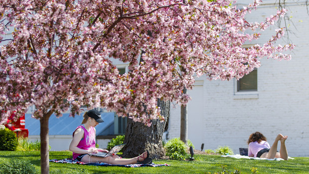 Kelsey Eihausen (from left), a sophomore from Bennington, and Molly Sambol, a junior from Omaha, study outside of the Phi Mu sorority on April 27.