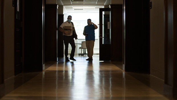Jack Dohrman (left) and Shawn Languis move to the next task as they measure rooms in Avery Hall earlier this month.