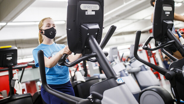Ellenor Sell works out wearing a mask after the Campus Recreation Center opened to patrons on June 15. After closing on March 23 due to COVID-19 concerns, Campus Rec facilities are now operating with a variety of safety concerns.