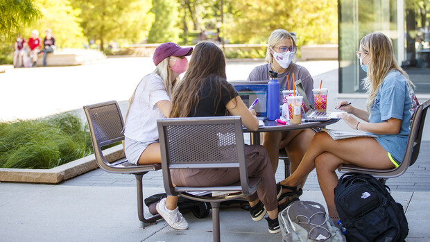 Alexis Carter talks with fellow Alpha Phi sorority members as they study outside of Adele Coryell Hall Learning Commons on Aug. 17, the first day of the fall semester. During the first week (Aug. 17-21), all campus instruction has been remote. The university beings offering in-person, on-campus instruction on Aug. 24.