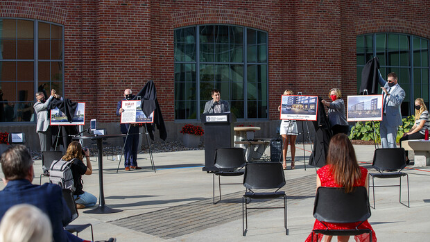 Campus and project leaders reveal the name of The Scarlet Hotel as Clint Runge talks during the Aug. 18 event at Nebraska Innovation Campus.