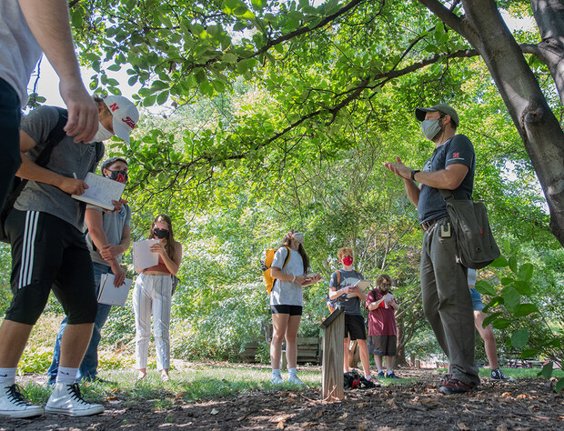 Students listen as Eric North, assistant professor of practice, outlines the features of a magnolia tree. This is just one example of how instructors are using the university's outdoor areas as teaching spaces.