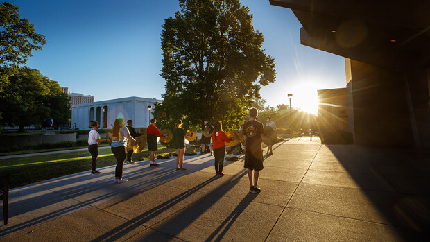 Cymbal players and the bass line from the Cornhusker Marching Band provide a sunrise serenade outside of Kimball Recital Hall on Sept. 2. While they aren't performing at football games this fall the band continues to practice, observing all public health rules.