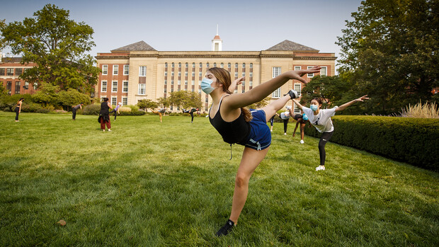 Sarah Mathis, a freshman from Lincoln, practices as part of a modern dance class outside of Love Library. The course is led by Susan Ourada.