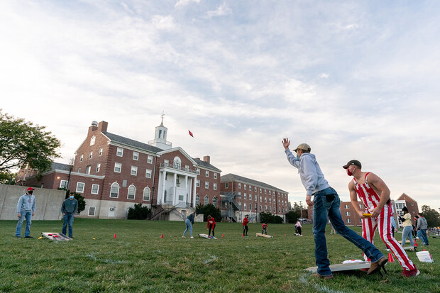 With Neihardt Hall in the background, students compete in the 2020 Homecoming Cornhole Competition on the Cather-Pound green space.