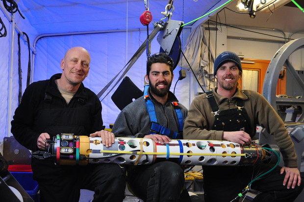 ANDRILL team members Bob Zook, Paul Mahecek and Dustin Carroll hold the underwater robot used to discover the sea anemone.