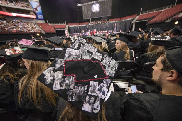 Kenzie Kucera, who earned a bachelor of science in education and human sciences, decorated her mortarboard with photos of friends and family.
