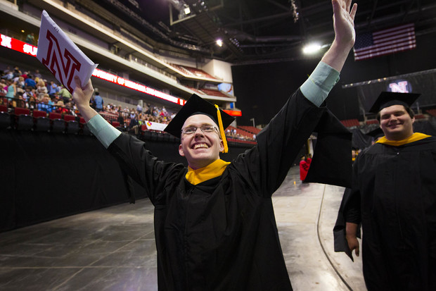 A student celebrates during the graduate and professional degrees ceremony on May 6.