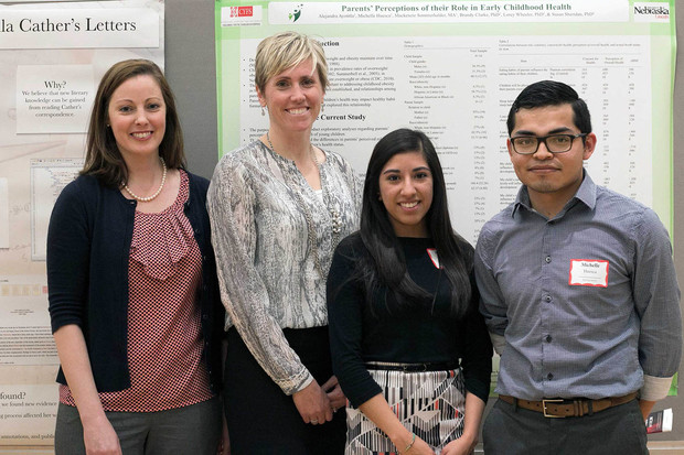 Lorey Wheeler and Brandy Clarke appear with undergraduate students Alejandra Ayotitla and Michelle Huesca at the 2016 UNL Research Fair. Ayotitla and Huesca were bilingual interpreters for the TAPP pilot study in Lincoln.