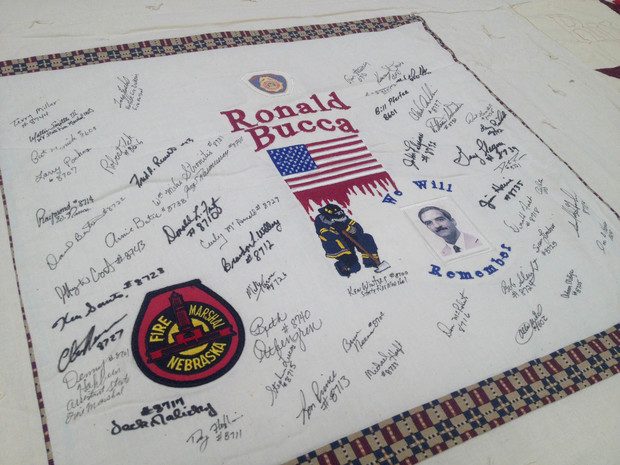 The memorial quilt includes a block for Ronald Bucca, a New York City fire marshal who was killed after ascending the World Trade Center's South Tower during rescue operations on Sept. 11, 2001. The block, which features a Nebraska Fire Marshal logo, also will be part of the quilt center exhibition.