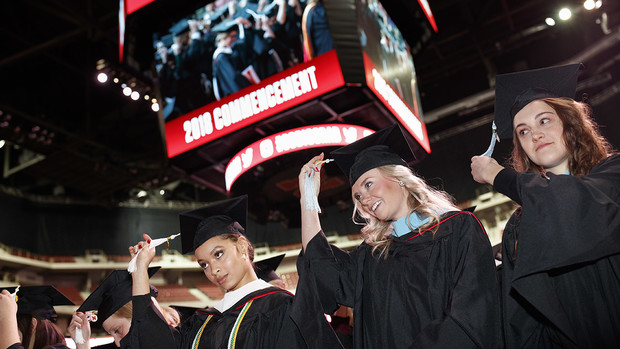 Virginia Hill (left), Master of Arts in political science; Hillary Hotz (center), Master of Arts in educational administration; and Melissa LaRosa (right), Master of Arts in educational psychology; move their tassels at the end of the graduate and professional degree ceremony Dec. 14 at Pinnacle Bank Arena.