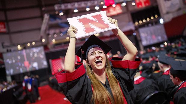 Hailey Lehms celebrates her newly earned Bachelor of Journalism as she returns to her seat during the morning undergraduate commencement ceremony May 4 at Pinnacle Bank Arena.