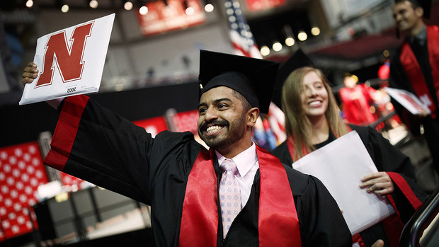 Khaled Saad Al Subaie waves to family and friends as he walks off stage after receiving his Bachelor of Journalism during the morning undergraduate commencement ceremony May 4 at Pinnacle Bank Arena.