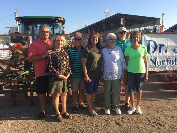 Neva Winter (third from right) poses with her daughters and their husbands July 10 at the Madison County Fair.
