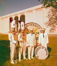 "Drum majors, with band directors Jack Snider and Don Lentz, stand in front of the large drum ""Big Bertha"" near the Sheldon Art Museum on Sept. 16, 1966."