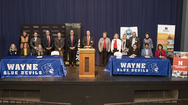 The Northeast Nebraska Agriculture and Natural Resources Education Compact was signed during a ceremony Oct. 29 at Wayne Junior/Senior High School in Wayne. The full cutline is available below.