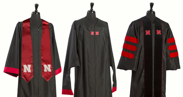 "Starting with spring commencement, gowns worn by graduates will feature the Nebraska ""N."" Gowns shown here are for (from left) undergraduate students, graduate students and doctoral students."