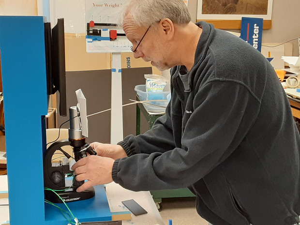 """Joel Nielson, graphics specialist and project coordinator at the University of Nebraska State Museum, constructs a microscopic interactive for """"H2O Today."""" The exhibition will blend information and hands-on experiences to tell the story of water globally and locally."""