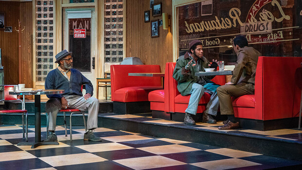 """Carson School alumnus Travis Banks (center) was featured in the St. Louis Black Repertory Company's production of """"Two Trains Running"""" in January. Also pictured are Ron Himes (left) and Jason Little."""