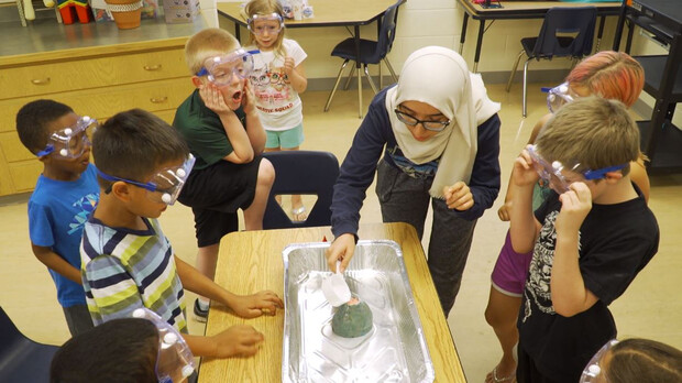 Nora Husein of Lincoln conducts a science experiment during her after-school club in 2019.