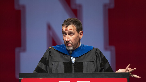 Daniel Linzell, associate dean for graduate and international programs in the College of Engineering and Leslie D. Martin Professor of Civil and Environmental Engineering, gives the keynote address during the graduate and professional degree ceremony Aug. 13 at Pinnacle Bank Arena.