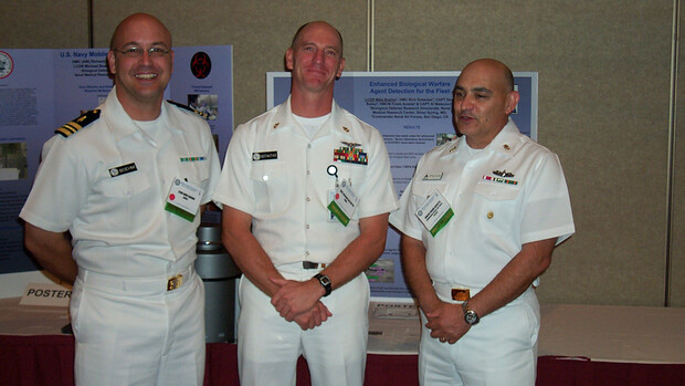 Lt. Cmdr. Mike Boehm and colleagues present a poster highlighting Navy bioweapons detection capabilities in Washington, D.C.