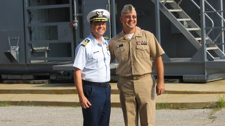 Coast Guard Cmdr. Anthony Popiel (left) and Navy Lt. Cmdr. Mike Boehm