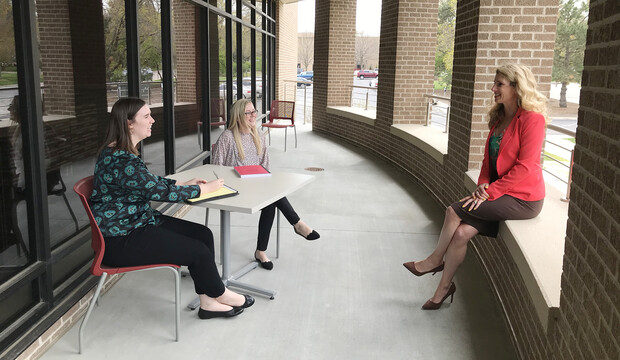 Claudia Brock (right), Rachel Lowe and Michelle Paxton talk outside the Schmid Clinic Building, where the Children's Justice Clinic is located.