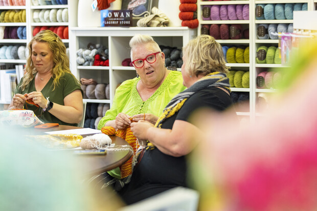 Knitters working on their hobby at a local yarn shop