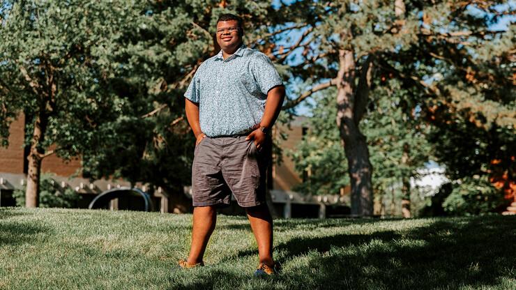 Nebraska's Jayven Brandt stands outside in the Sheldon Sculpture Garden.