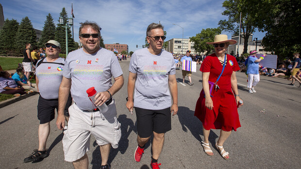 Corrie Svehla (second from left) walks the Star City Pride parade route with (from left) Bob Wilhelm, Ronnie Green, and Jane Green. More than 40 members of the campus community walked as part of the Husker Pride entry in the inaugural parade.
