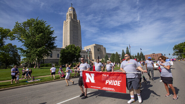 The Husker Pride group walks the parade route around the Nebraska State Capitol on June 19. Thousands attended the inaugural parade.