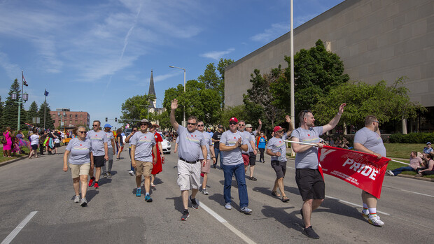 Members of the Husker Pride entry walk the parade route on June 19.