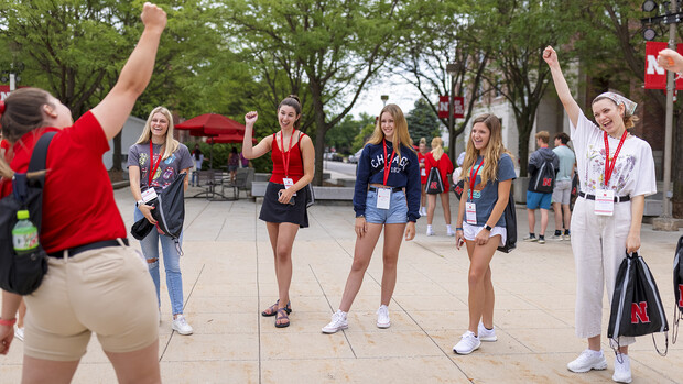 Luiza Benvenuti (left) fires up her student group prior to introductions during a New Student Enrollment session on June 24.