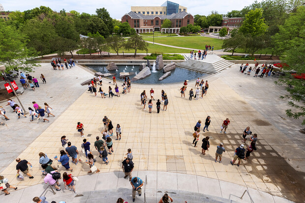 Parents and incoming students break into groups on the Nebraska Union Plaza as the afternoon session of New Student Enrollment begins on June 24.
