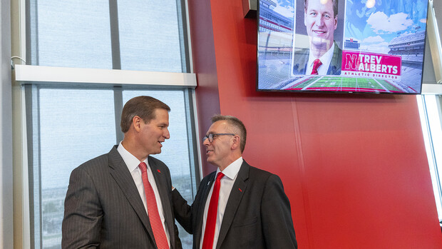 Chancellor Ronnie Green and Trev Alberts chat before the July 14 announcement in Memorial Stadium.